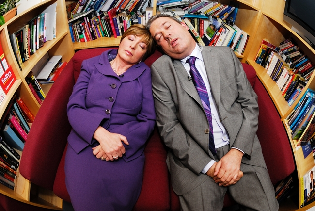 Calendar News Presenters fake taking a nap as part of their Sarahphotogirl Feature at Leeds Studios.