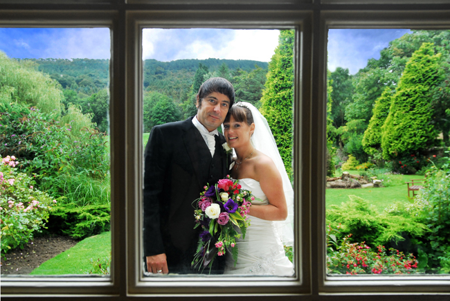 The Bride and Groom framed by a window