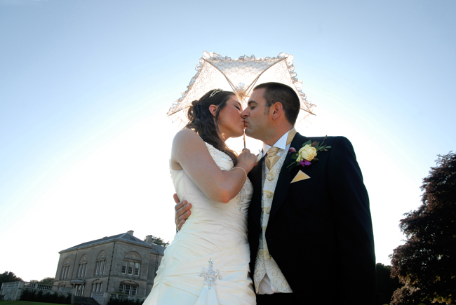 The Bride and Groom under a parasol